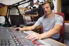 Handsome happy radio host moderating. In studio at college Stock Image