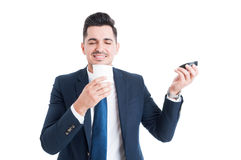 Handsome happy salesman smelling a cup of fresh coffee Stock Image