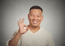 Handsome, happy, smiling, excited man employee giving OK sign Stock Image