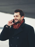Handsome happy smiling man talking by smartphone royalty free stock photo