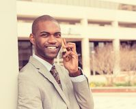 Handsome happy young businessman talking on mobile phone Stock Photos