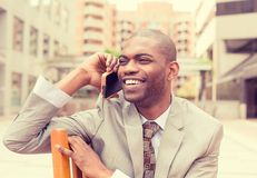 Handsome happy young businessman talking on mobile phone Royalty Free Stock Images