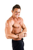 Handsome Healthy young man with muscular torso posing smiling. Isolated on white background. Stock Photo