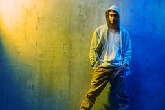 Handsome hi hop dancer leaning on  a concrete wall Stock Photography