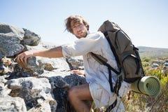 Handsome hiker hiking through rough terrain Royalty Free Stock Photos