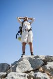 Handsome hiker standing at the summit Stock Image