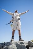 Handsome hiker standing at the summit Royalty Free Stock Photo