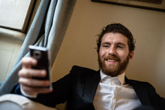Handsome hipster elegant man on the cellphone royalty free stock images
