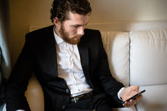 Handsome hipster elegant man on the cellphone stock images