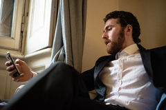 Handsome hipster elegant man on the cellphone Royalty Free Stock Photo