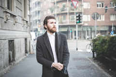 Handsome hipster elegant man in the city Stock Images