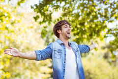 Handsome hipster feeling free in the park Stock Image