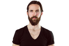 Handsome hipster frowning at camera Stock Image
