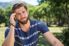 Handsome hipster getting a headache Royalty Free Stock Image