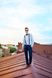 Handsome  hipster guy on the roof Stock Photo