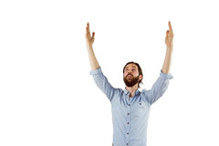 Handsome hipster with his arms raised Stock Photo