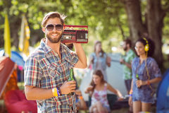 Handsome hipster holding retro cassette player Royalty Free Stock Photos