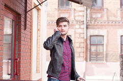 Handsome hipster in leather jacket Stock Images