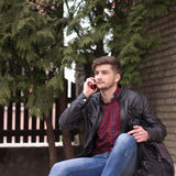 Handsome hipster in leather jacket Royalty Free Stock Images