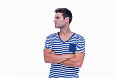 Handsome hipster looking away with arms crossed Royalty Free Stock Images