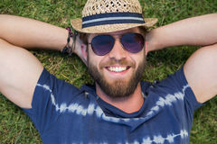 Handsome hipster lying on grass Royalty Free Stock Image