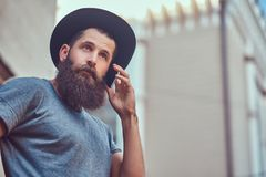 A handsome hipster male with a stylish beard and tattoo on his a stock images