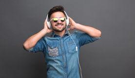 Handsome hipster man in earphones Stock Image