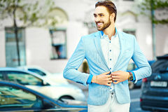 Handsome hipster man in suit in the street Stock Images