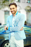 Handsome hipster man in suit in the street Royalty Free Stock Photo