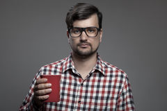 Handsome hipster modern man and cup of coffee in hand. Stock Images