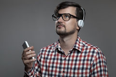Handsome hipster modern man listen music in headphones. Stock Images
