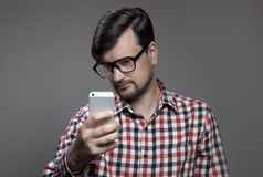 Handsome hipster modern man self shooting on smartphone camera. Stock Photo