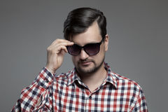 Handsome hipster modern man in sunglasses. Stock Image