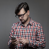 Handsome hipster modern man using smartphone. Stock Photos