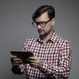 Handsome hipster modern man using tablet. Stock Photo