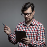 Handsome hipster modern man using tablet. Royalty Free Stock Photo