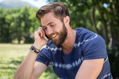 Handsome hipster on the phone in park Stock Photos