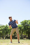 Handsome hipster playing air guitar Stock Images