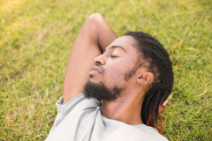Handsome hipster relaxing in the park Stock Photo