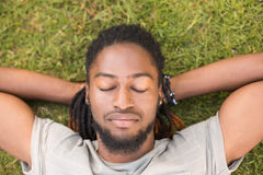 Handsome hipster relaxing in the park Royalty Free Stock Photos