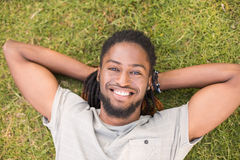Handsome hipster relaxing in the park Royalty Free Stock Image