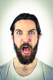 Handsome hipster shouting at camera Royalty Free Stock Photos