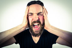 Handsome hipster shouting at camera Royalty Free Stock Photo