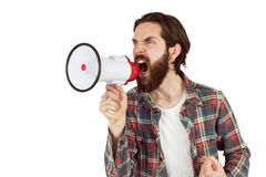 Handsome hipster shouting through megaphone Stock Image