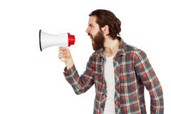 Handsome hipster shouting through megaphone Stock Images