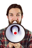 Handsome hipster shouting through megaphone Royalty Free Stock Photos