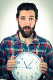 Handsome hipster showing a clock Royalty Free Stock Image