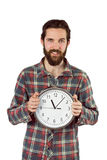 Handsome hipster showing a clock Stock Photography