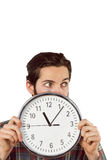 Handsome hipster showing a clock Royalty Free Stock Photos