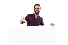 Handsome hipster showing large poster Stock Photos